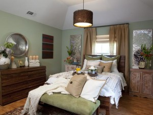 Brown accents and layered bedding create a beautiful, warm-looking bedroom