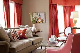 Persimmon-colored drapes and pillows